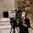 Vatican videographer in a mask